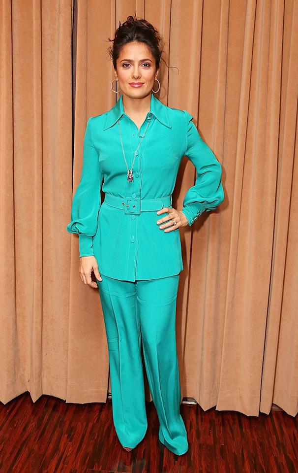 Is it just us, or is Salma Hayek way too sexy to be sporting an outfit fit for a '70s housewife? Discuss. (4/17/2013)