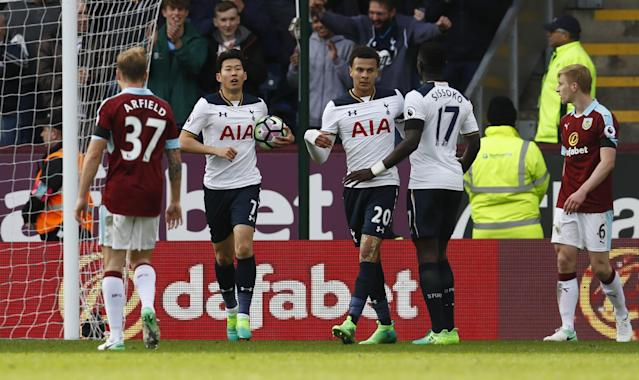 Tottenham's Son Heung-min celebrates scoring their second goal with team mates as Burnley's Ben Mee (R) looks dejected