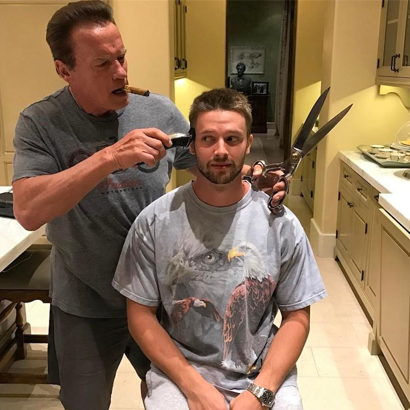 """<p>Just because you're 23 doesn't mean dear old dad can't help you out with a trim. But when your dad is the Terminator, that might mean giant scissors in addition to the electric razor. Oh, and a cigar! (Photo: Patrick Schwarzenegger via<a rel=""""nofollow"""" href=""""https://www.instagram.com/p/BSP6iSYByvu/?taken-by=patrickschwarzenegger&hl=en"""">Instagram</a>) </p>"""