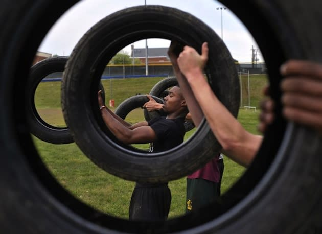 The Louisa High football team completes a strength workout with used tires —The Washington Post