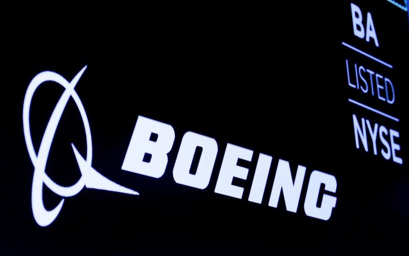 The Boeing logo is displayed on a screen at the NYSE in New York