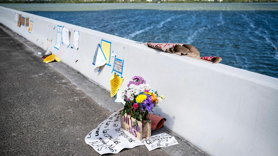 Flowers and messages, pictured here on the Teodoro Moscoso Bridge where the body of Keishla Rodriguez was dumped.