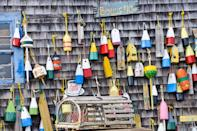 <p>Even the decorative lobster buoys set against a wood-paneled wall is a sight to behold on the Cape.</p>
