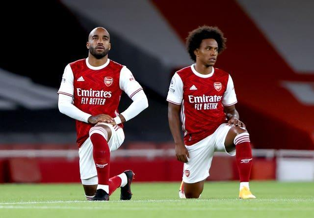 Alexandre Lacazette (left) and Willian were among those who missed the Brentford game due to Covid.
