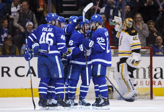 The Toronto Maple Leafs celebrate a goal against the Boston Bruins during the first period of an NHL hockey game Saturday, Feb. 24, 2018, in Toronto. (Cole Burston/The Canadian Press via AP)