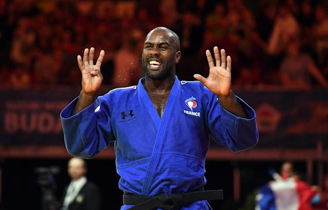 Gold medalist France's Teddy Riner (blue) celebrates on the tatami after his final in the men's +100kg category at the World Judo Championships in Budapest on September 2, 2017. (AFP Photo/ATTILA KISBENEDEK)