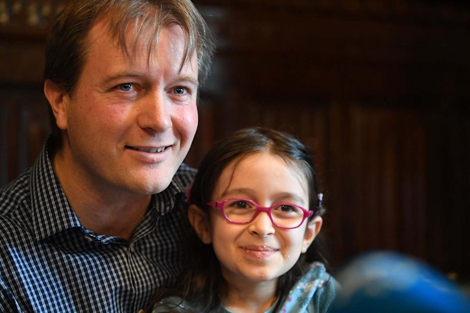 Richard Ratcliffe, with their daughter Gabriella Zaghari-Ratcliffe hours after she returned to the UK. (PA)
