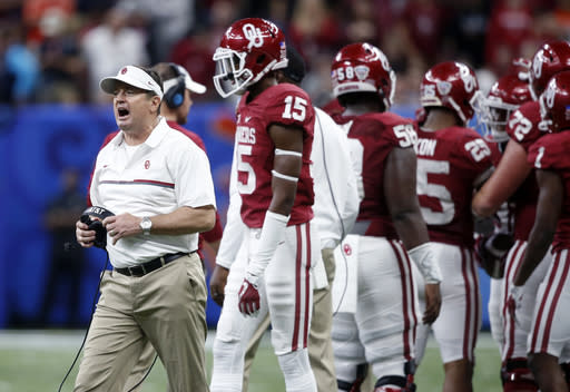 FILE - In this Jan. 2, 2017, file photo, Oklahoma coach Bob Stoops calls out from the sideline during the second half of the team's Sugar Bowl NCAA college football game against Auburn in New Orleans. Stoops is helping coach the Sooners again because of coronavirus issues. The Sooners had last Saturdays game at West Virginia postponed, and they temporarily paused organized team activities due to positive COVID-19 tests and contact tracing throughout the program. The situation affected the assistant coaching ranks, leading Oklahoma coach Lincoln Riley to ask Stoops for help. (AP Photo/Gerald Herbert, File)