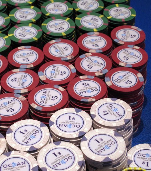In this June 18, 2019 photo gambling chips sit on a table at the Ocean Casino Resort in Atlantic City, N.J. New Jersey's casinos won nearly $3.3 billion from gamblers in 2019, the first time since 2012 that the Atlantic City gambling halls had won more than $3 billion, according to figures released Tuesday, Jan. 14, 2020, by the New Jersey Division of Gaming Enforcement. (AP Photo/Wayne Parry)