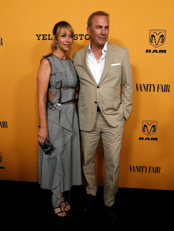 """Cast member Kevin Costner and his wife Christine Baumgartner pose at a premiere for the television series """"Yellowstone"""" in Los Angeles, California, U.S., June 11, 2018. REUTERS/Mario Anzuoni"""