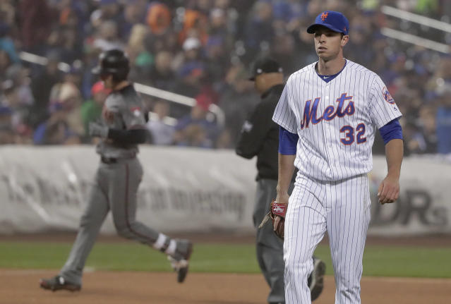 New York Mets pitcher Steven Matz (32) reacts after giving up a two-run home run to Arizona Diamondbacks' John Ryan Murphy during the fourth inning of a baseball game, Saturday, May 19, 2018, in New York. (AP Photo/Julie Jacobson)
