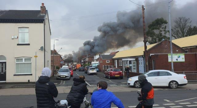 Smoke rises from a fire at a three-storey warehouse in Holland Street, Denton, Manchester