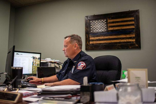 PHOTO: Police Chief Micheal Tupper works in his office at the Marshalltown Police Department in Marshalltown, Iowa, Aug. 7, 2019. (Sergio Flores for ABC News)