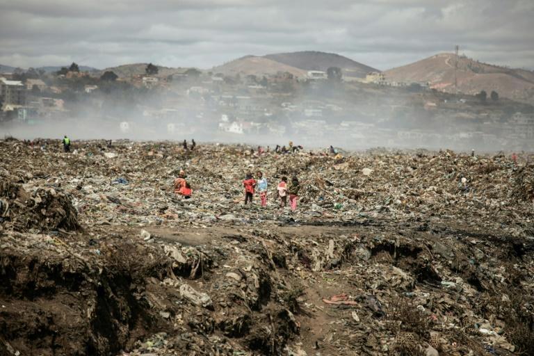 Children and waste pickers sift through garbage at a landfill near 'Cite Akamasoa' - 'Akamasoa Town'