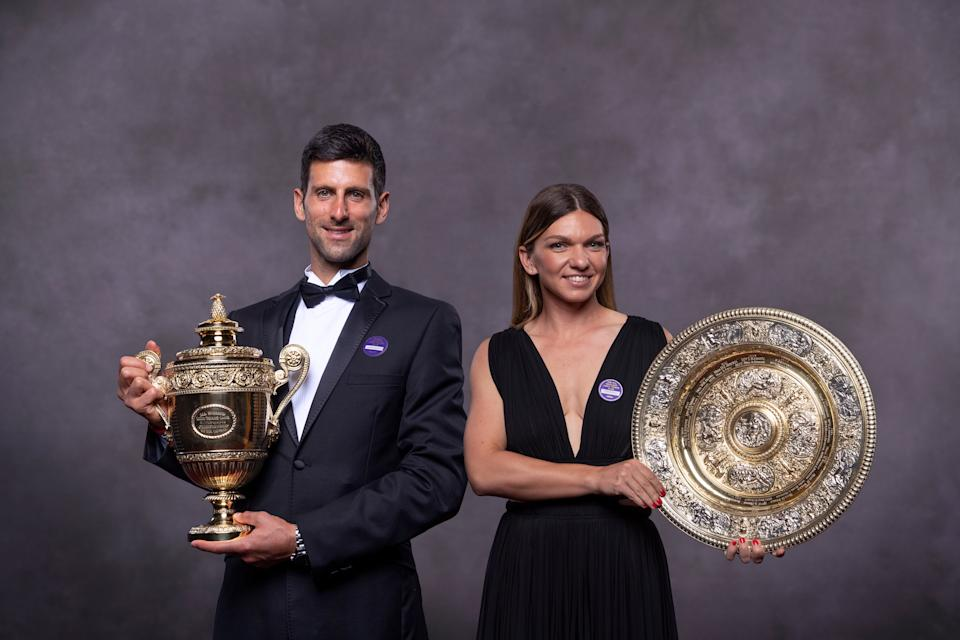 In this handout image supplied by the All England Lawn Tennis Club, Simona Halep of Romania and Novak Djokovic of Serbia, the Ladies Singles and Gentlemens Singles champion photographed at the Champions' Dinner at The Guildhall on July 14, 2019 in London, England. (Photo by Thomas Lovelock / AELTC via Getty Images)