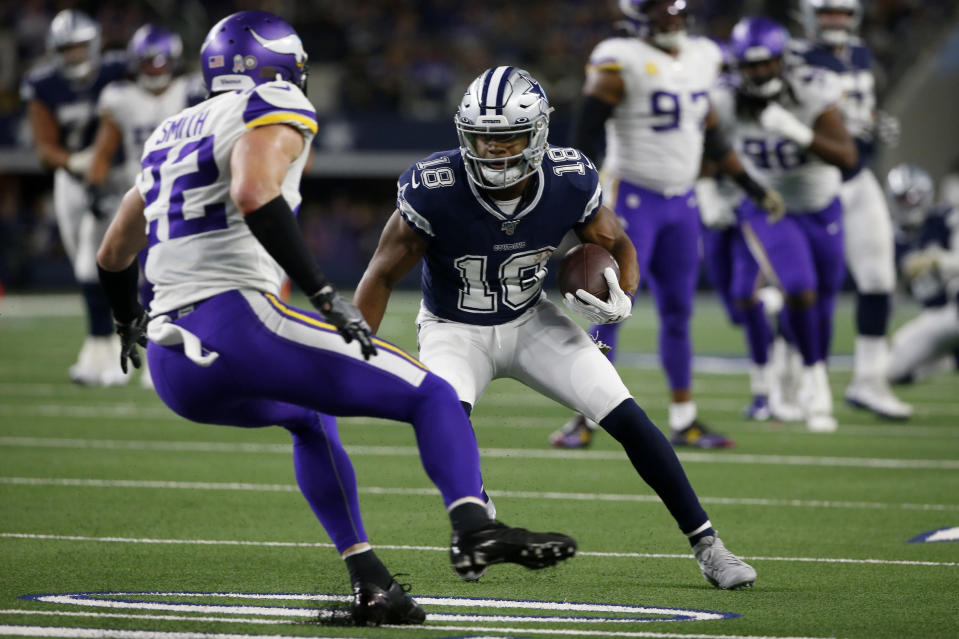 Minnesota Vikings' Harrison Smith (22) defends as Dallas Cowboys' Randall Cobb (18) looks for running room after catching a pass during the second half of an NFL football game in Arlington, Texas, Sunday, Nov. 10, 2019. (AP Photo/Ron Jenkins)