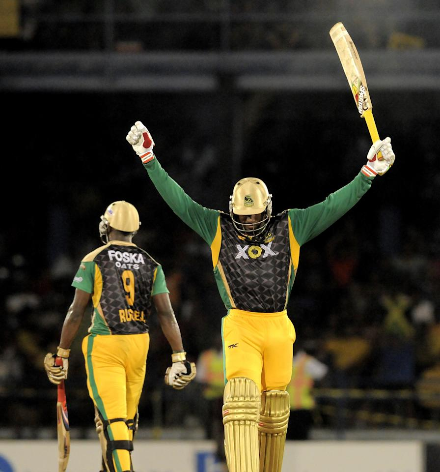 PORT OF SPAIN, TRINIDAD AND TOBAGO - AUGUST 24:  Chris Gayle of Jamaica Tallawahs celebrates the score tied against Guyana Amazon Warriors during the Final of the Caribbean Premier League between Guyana Amazon Warriors v Jamaica Tallawahs at Queens Park Oval on August 24, 2013 in Port of Spain, Trinidad and Tobago. (Photo by Randy Brooks/Getty Images Latin America for CPL)