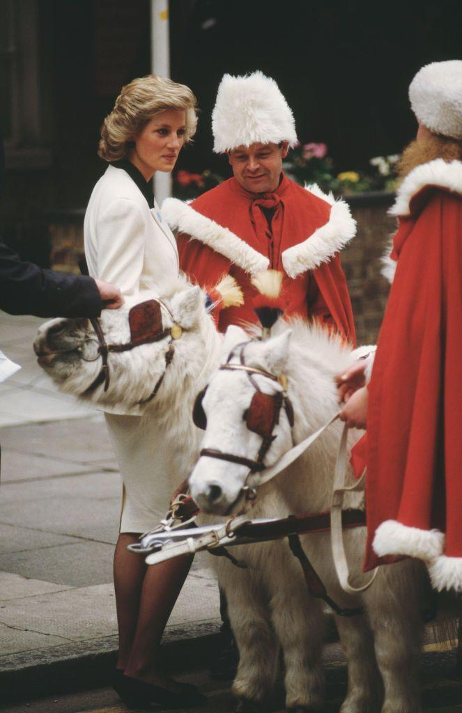 <p>Princess Diana meets some Christmassy fans during a visit to a children's hospital.</p>