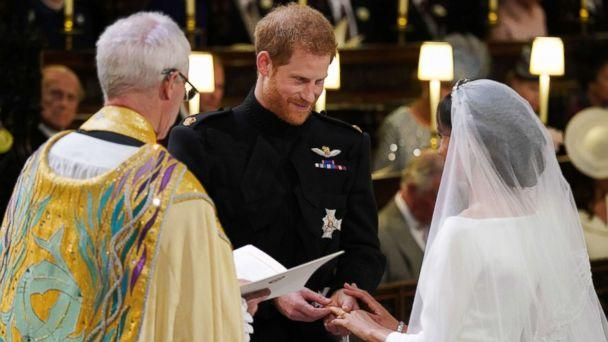 PHOTO: Prince Harry, Duke of Sussex, places the wedding ring on Meghan Markle during their wedding ceremony in St George's Chapel, Windsor Castle, in Windsor, on May 19, 2018. (Jonathan Brady/AFP/Getty Images)