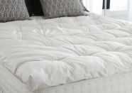 """<p>plushbeds.com</p><p><strong>$367.00</strong></p><p><a href=""""https://go.redirectingat.com?id=74968X1596630&url=https%3A%2F%2Fwww.plushbeds.com%2Fproducts%2Fplushbeds-natural-luxury-handmade-wool-topper&sref=https%3A%2F%2Fwww.housebeautiful.com%2Fshopping%2Fhome-accessories%2Fg37129584%2Fbest-mattress-toppers%2F"""" rel=""""nofollow noopener"""" target=""""_blank"""" data-ylk=""""slk:BUY NOW"""" class=""""link rapid-noclick-resp"""">BUY NOW</a></p><p>Made of 100 percent wool, this topper naturally keeps you cool in the summer and warm in the winter. It's cruelty-free, handmade in the United States, hypoallergenic, <em>and</em> non-toxic. What more could you want?</p>"""