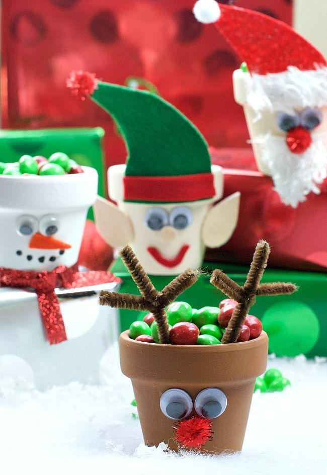 """<p>Collect mini flower pots for this easy holiday craft. Use basic craft supplies such as googly eyes, pipe cleaners, and felt to bring them to life as Christmas characters like a reindeer, elf, and snowman.</p><p><em><a href=""""https://crazylittleprojects.com/holiday-character-candy-pots/"""" rel=""""nofollow noopener"""" target=""""_blank"""" data-ylk=""""slk:Get the tutorial at Crazy Little Projects"""" class=""""link rapid-noclick-resp"""">Get the tutorial at Crazy Little Projects</a></em></p>"""