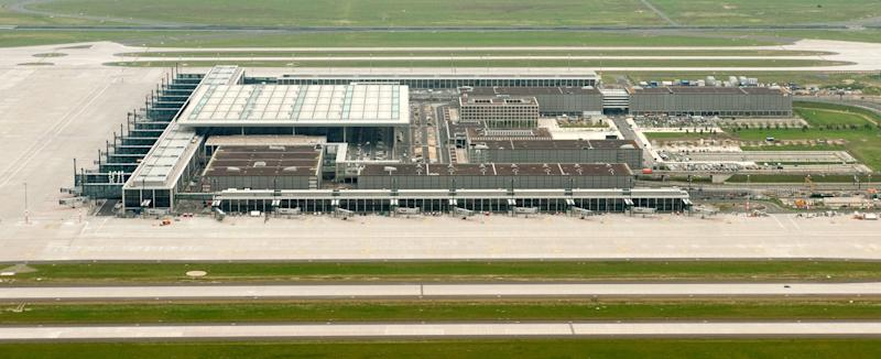 """File - This June 27, 2012 file picture shows an aerial view of the new Berlin Airport, Willy Brandt (BER). The opening of Berlin's new airport may be postponed for a fourth time - the latest delay in a project that has turned into a major embarrassment for German officials. The Willy Brandt airport was originally slated to open in 2011. After two delays last year, it was supposed to open on Oct. 27, 2013. But Transport Ministry spokesman Sebastian Rudolph said Monday Jan. 7, 2013 that officials were told last week airport managers see new """"major"""" problems. He didn't elaborate. Germany's Bild newspaper, citing internal documents, reported that the airport won't be able to open before 2014 at the earliest. (AP Photo/ dapd/ Klaus-Dietmar Gabbert,File)"""
