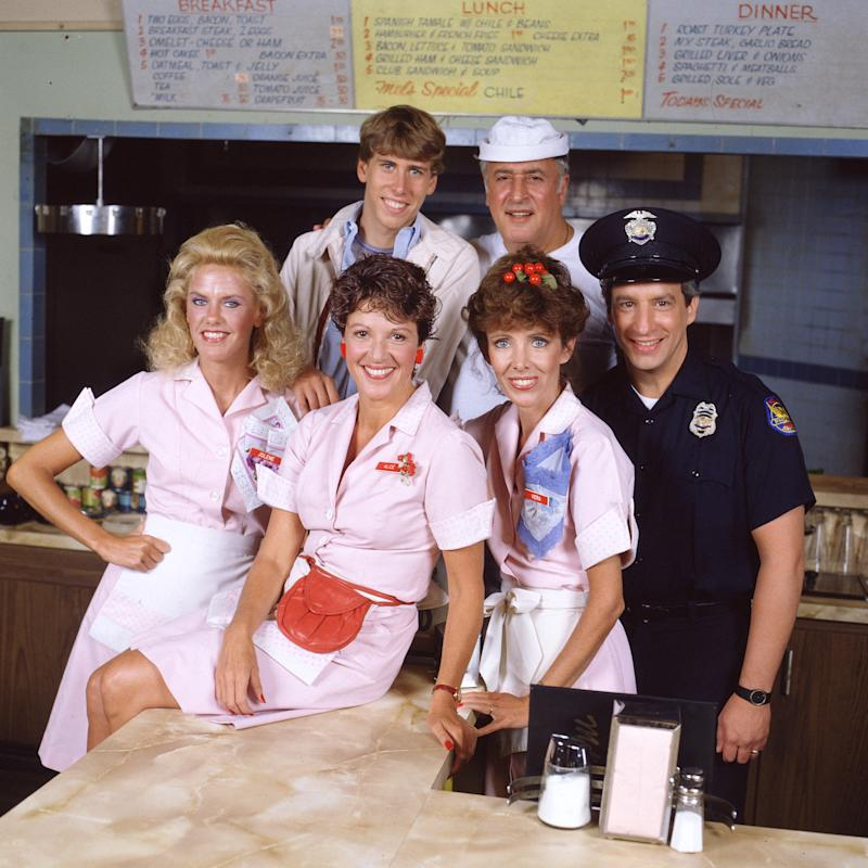LOS ANGELES - JUNE 1: Alice, a television situation comedy, originally broadcast on CBS. Featuring (in front, left to right) Celia Weston (as waitress Jolene Hunnicutt), Linda Lavin (as waitress Alice Hyatt), Beth Howland (as waitress Vera Louise Gorman) and Charles Levin (as police officer Elliot Novak). In back, left to right, Philip McKeon (as Tommy Hyatt) and Vic Tayback (as Mel Sharples, diner owner and cook). Image dated June 1, 1984. (Photo by CBS via Getty Images)