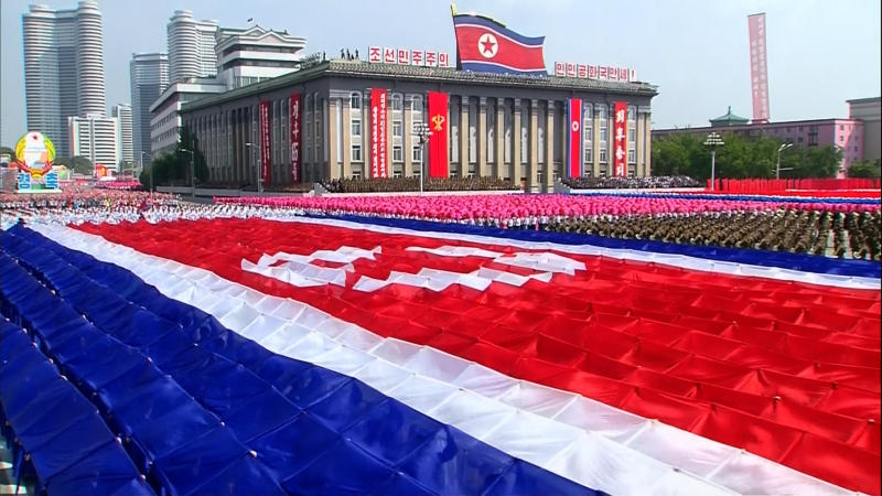 In this image taken from video North Koreans form a North Korean flag while performing during a military parade marking the 65th anniversary of the country's founding, Monday, Sept. 9, 2013, in Pyongyang, North Korea. (AP Photo/KRT via AP Video) TV OUT, NORTH KOREA OUT