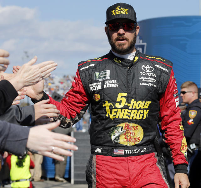 Martin Truex Jr., greets fans during driver introductions prior to the start of the Monster Energy NASCAR Cup Series race at Martinsville Speedway in Martinsville, Va., Sunday, Oct. 28, 2018. (AP Photo/Steve Helber)