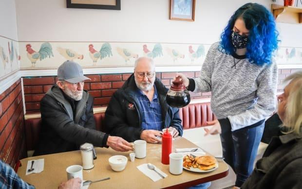 Patrons dined in at Hunter's Country Kitchen in Carstairs, Alta., as the province began easing restrictions in February.