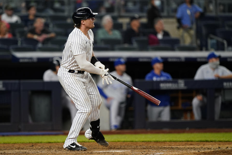New York Yankees Luke Voit watches his ninth-inning, walk-off RBI single in the Yankees 6-5 win over the Kansas City Royals in a baseball game, Wednesday, June 23, 2021, at Yankee Stadium in New York. (AP Photo/Kathy Willens)