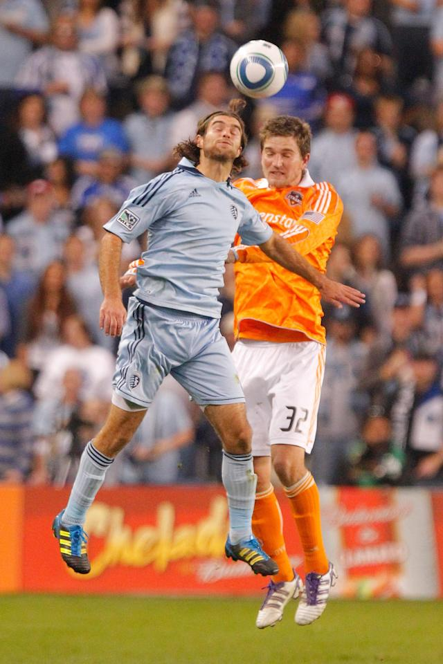 KANSAS CITY, KS - NOVEMBER 06: Graham Zusi #08 of the Sporting Kansas City and Bobby Boswell #32 of the Houston Dynamo attempt to gain control of a header in the first half during the MLS Eastern Conference Championship match at Livestrong Sporting Park on November 06, 2011 in Kansas City, Kansas. (Photo by Kyle Rivas/Getty Images)