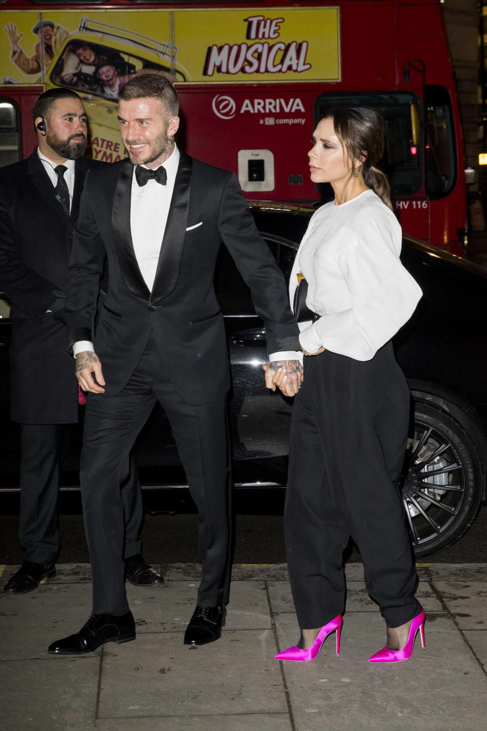 <p>The husband and wife duo co-ordinated in monochrome looks for the event, which the Duchess of Cambridge also attended. Victoria added a pop of colour to her look with a pair of hot pink heels. <em>[Photo: Getty]</em> </p>