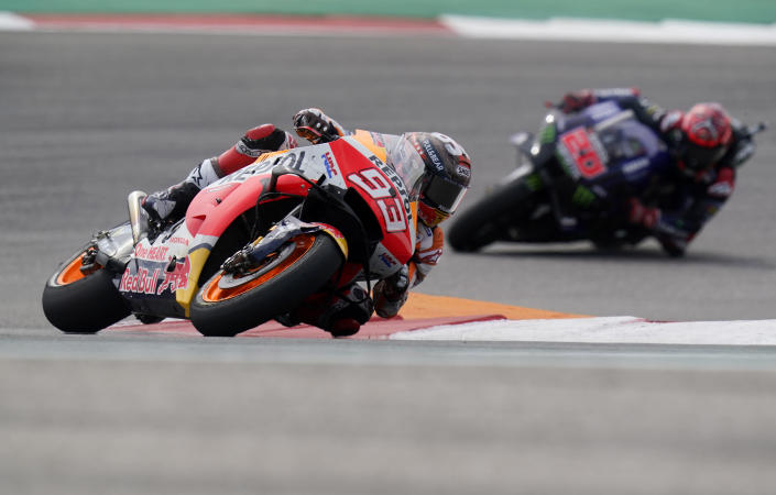 Spain's Marc Marquez (93) steers through a turn ahead of Fabio Quartararo (20), of France, during the MotoGP Grand Prix of the Americas motorcycle race at Circuit of the Americas, Sunday, Oct. 3, 2021, in Austin, Texas. (AP Photo/Eric Gay)