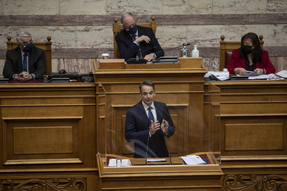 Greek Prime Minister Kyriakos Mitsotakis speaks during a parliamentary session in Athens, Thursday, Feb. 25, 2021.Mitsotakis has promised to outline proposed legal changes in parliament on Thursday to make it easier for victims of sexual assault to report the crimes. (AP Photo/Petros Giannakouris)