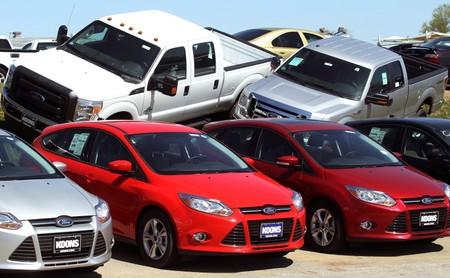 FILE PHOTO: A row of Ford Focus are displayed next to Ford F-Series pickups at Koons Ford in Silver Spring