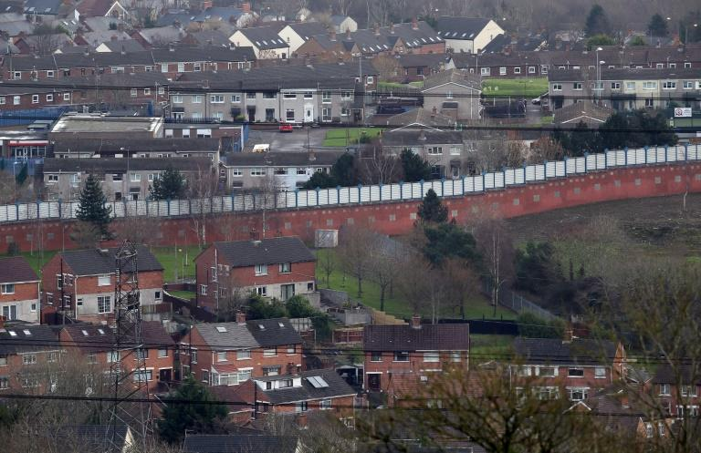 A peace wall separates the Catholic and Protestant communities in Belfast.