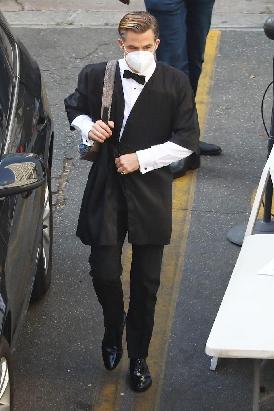 <p>Chris Pine is seen in a suit on the set of <i>Don't Worry Darling</i> in L.A. on Tuesday. </p>