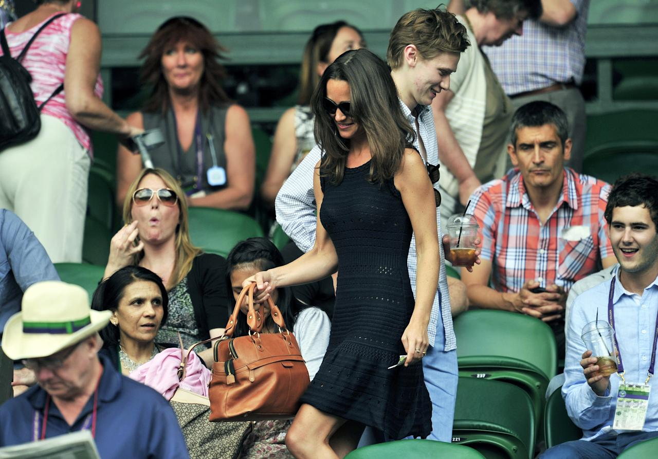Pippa Middleton, sister of Catherine, Duchess of Cambridge, arrives for a semifinal between Spanish player Rafael Nadal and British player Andy Murray at at the Wimbledon Tennis Championships at the All England Tennis Club, in southwest London on July 1, 2011. AFP PHOTO / GLYN KIRK RESTRICTED TO EDITORIAL USE (Photo credit should read GLYN KIRK/AFP/Getty Images)