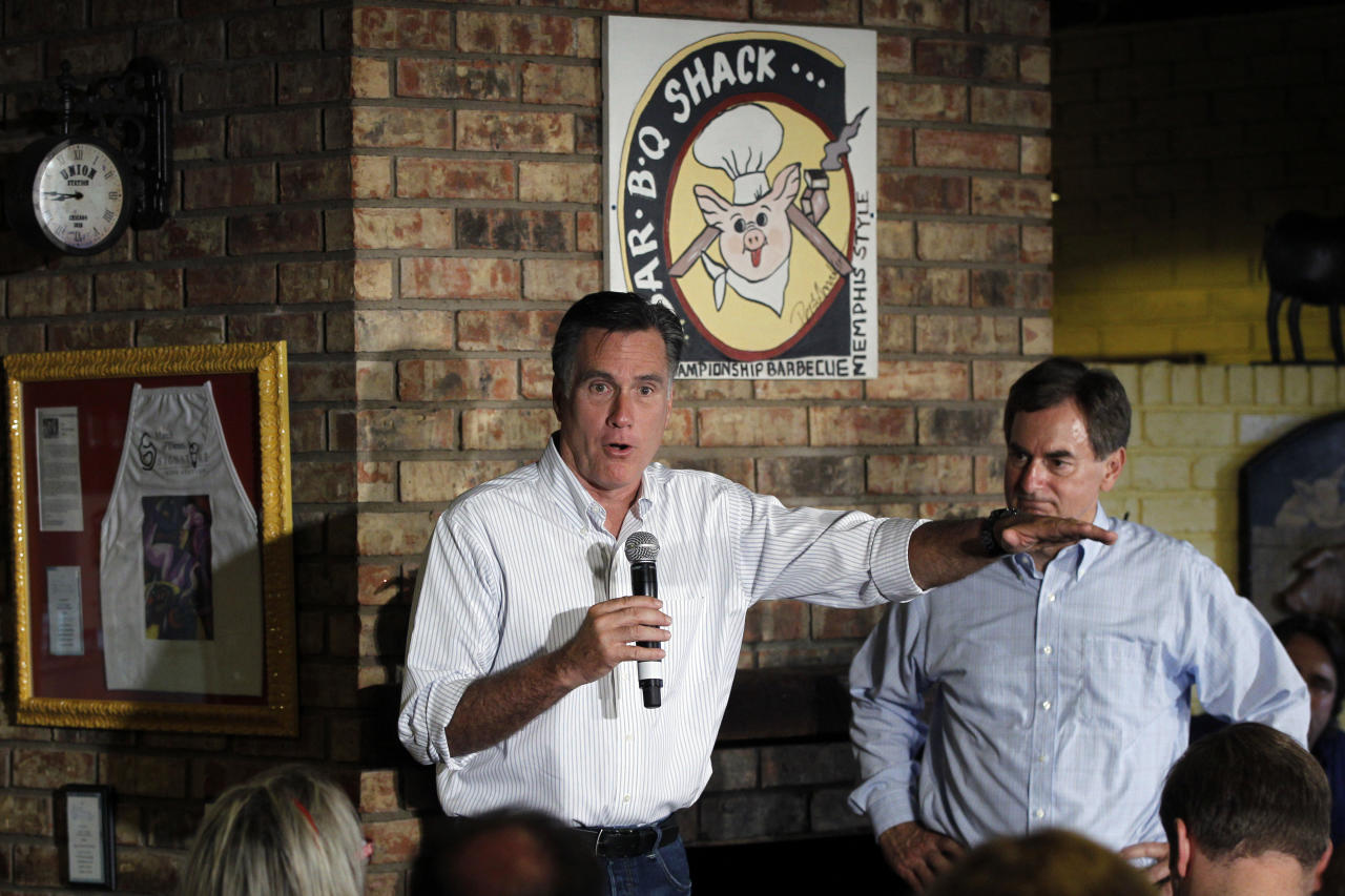 Republican presidential candidate and former Massachusetts Gov. Mitt Romney campaigns with Richard Mourdock who is running for Senate at Stepto's BBQ Shack in Evansville, Ind., Saturday, Aug. 4, 2012. (AP Photo/Charles Dharapak)