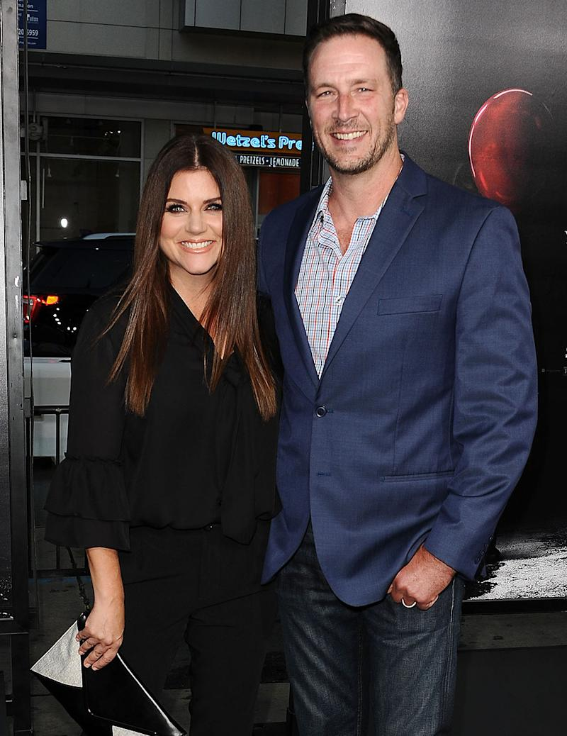 Tiffani Thiessen and husband Brady Smith attend a movie premiere. (Photo: Getty Images)