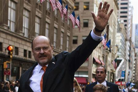 Republican New York City mayoral candidate Joe Lhota waves to people as he attends the 69th Annual Columbus Day Parade in New York, October 14, 2013. REUTERS/Eduardo Munoz