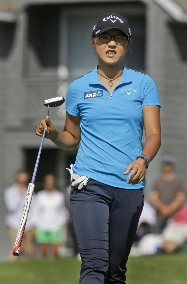 Lydia Ko, of New Zealand, grimaces as she missed a putt on the ninth green during the final round of the Kingsmill Championship golf tournament at the Kingsmill resort in Williamsburg, Va., Sunday, May 18, 2014. (AP Photo/Steve Helber)