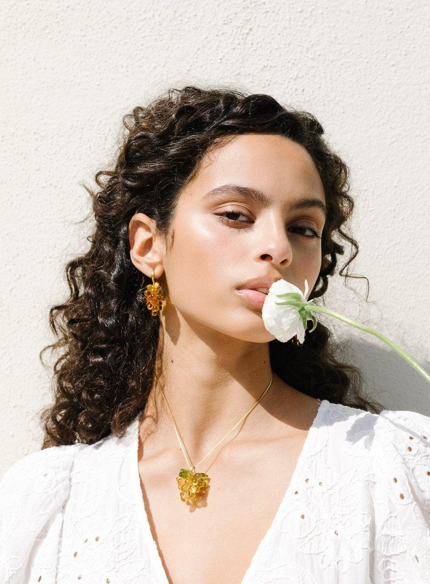 <p><span>ANNELE Apricot Jelly Clip-On Earrings</span> ($150) and <span>ANNELE Lucky Lemonade Necklace</span> ($130)</p>