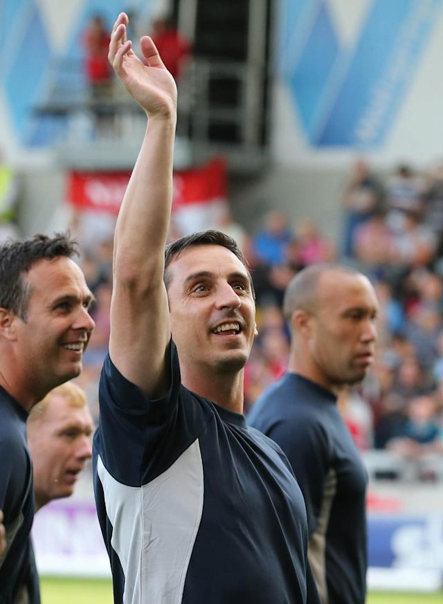 Former Manchester United defender Gary Neville believes manager Louis van Gaal is on the right track at Old Trafford (AFP Photo/Lindsey Parnaby)