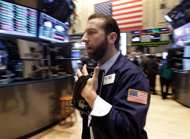 Trader Greg Mulligan works on the floor of the New York Stock Exchange Monday, Dec. 16, 2013. The stock market is opening sharply higher after a pair of multibillion-dollar deals and signs of strength in U.S. manufacturing. (AP Photo/Richard Drew)