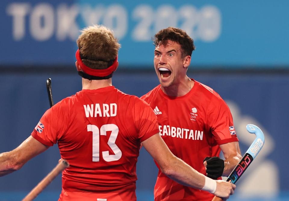<p>TOKYO, JAPAN - AUGUST 01: Samuel Ian Ward of Team Great Britain celebrates with teammate Phillip Roper after scoring their team's first goal during the Men's Quarterfinal match between India and Great Britain on day nine of the Tokyo 2020 Olympic Games at Oi Hockey Stadium on August 01, 2021 in Tokyo, Japan. (Photo by Naomi Baker/Getty Images)</p>