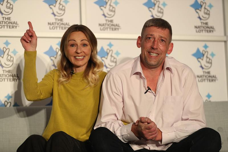 Self-employed builder Steve Thomson, right, and his wife Lenka, from Selsey, West Sussex, have won £105 million (Picture: PA)
