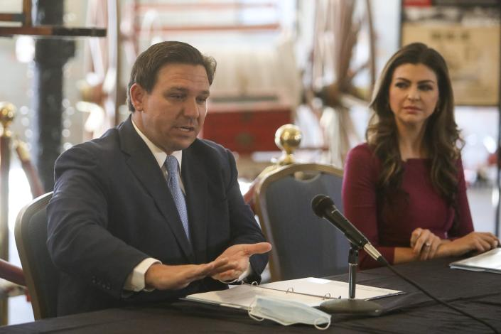 Gov. Ron DeSantis answers questions while First Lady Casey DeSantis listens at a mental health symposium in Tampa.