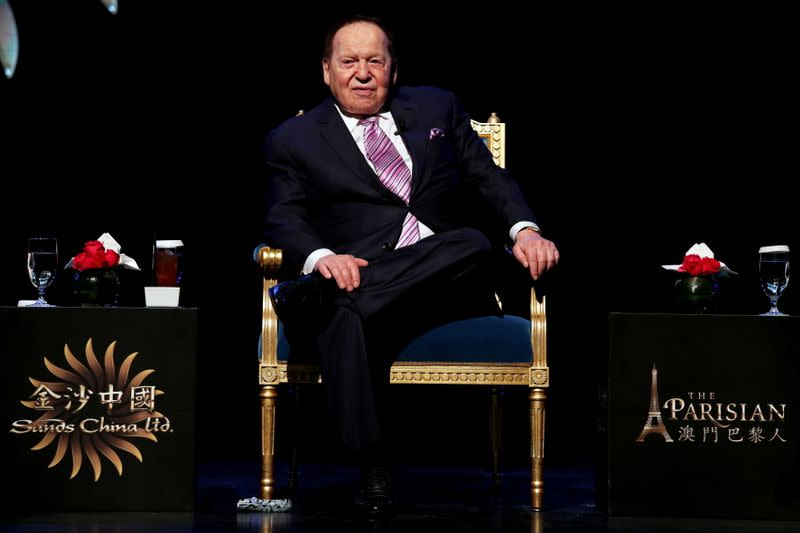 FILE PHOTO: Las Vegas Sands Corp Chairman and Chief Executive Sheldon Adelson attends a news conference on the opening of Parisian Macao in Macau